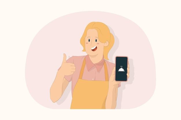 젊은 요리사 요리사 제빵사 여성은 휴대 전화에서 조리법을 보여주며 엄지손가락 제스처 개념을 보여줍니다.