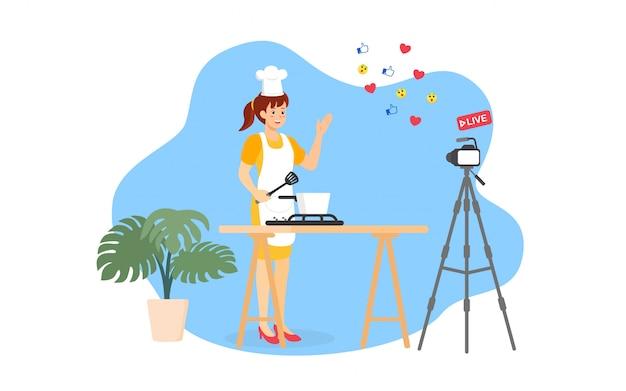 격리 시간에 비디오 스트리밍 라이브를 통해 부엌에서 요리하는 젊은 요리사 여자.