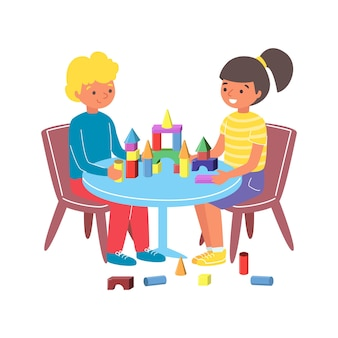 Young children play toy wooden constructor