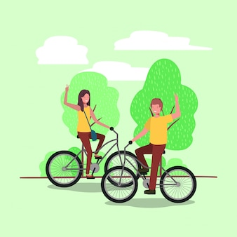 Young couple on bicycle in the park