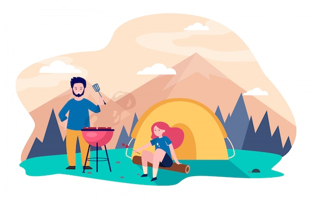 Young couple camping at mountains