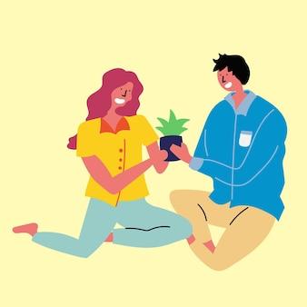 Молодая пара заботится о растении вместе