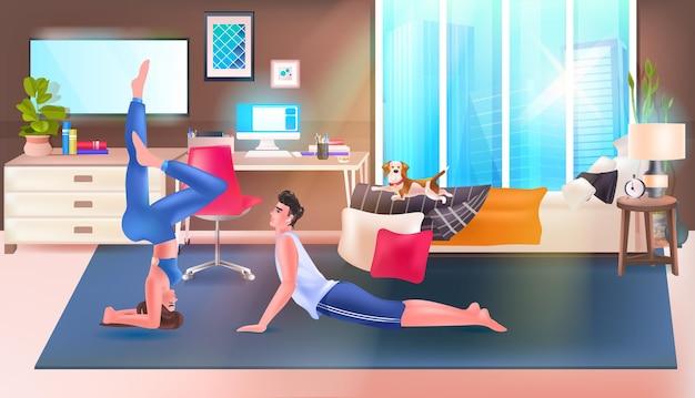 ヨガ運動リラクゼーション健康的なライフスタイルの概念の寝室のインテリアをやっている若いカップル