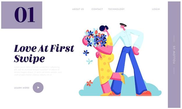 Молодая пара встречается. милая девушка держать букет цветов в руках, мужчина обнимает подругу.