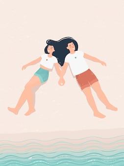 海でバカンス愛の若いカップル