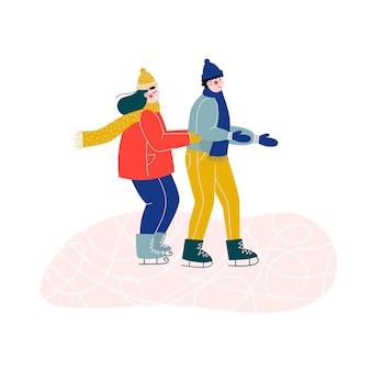 手をつないで、アイススケートリンクで一緒にスケートをする女性と男性の若いカップル。