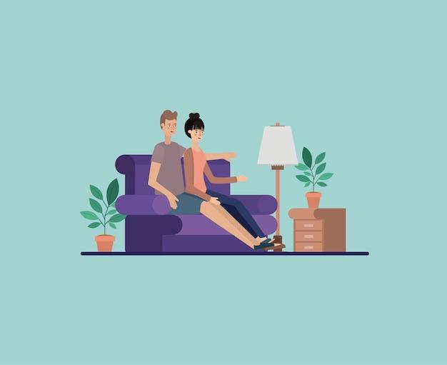 Молодая пара, расслабляющий на гостиной