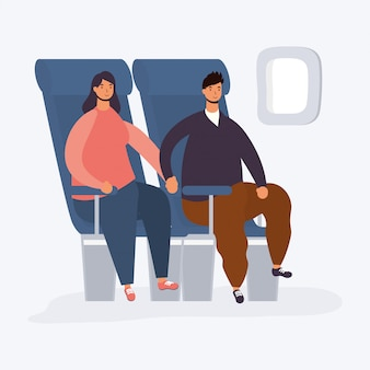 Young couple seated in airplane chairs