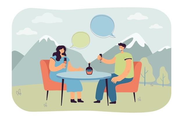 テーブルに座って、山でシャンパンを飲む若いカップル。日付フラットイラストで話している男性と女性