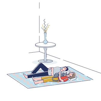 若いカップルが寝室の床で一緒に寝る夢を見て床に横たわっている男性と女性