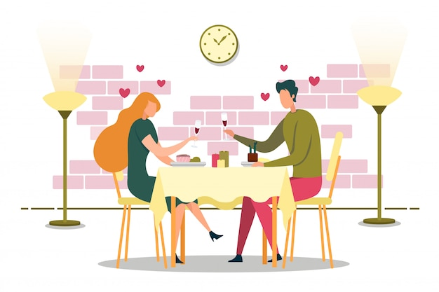Young couple spending time on date in cozy cafe.