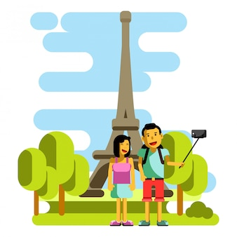Young couple taking selfie near eiffel tower