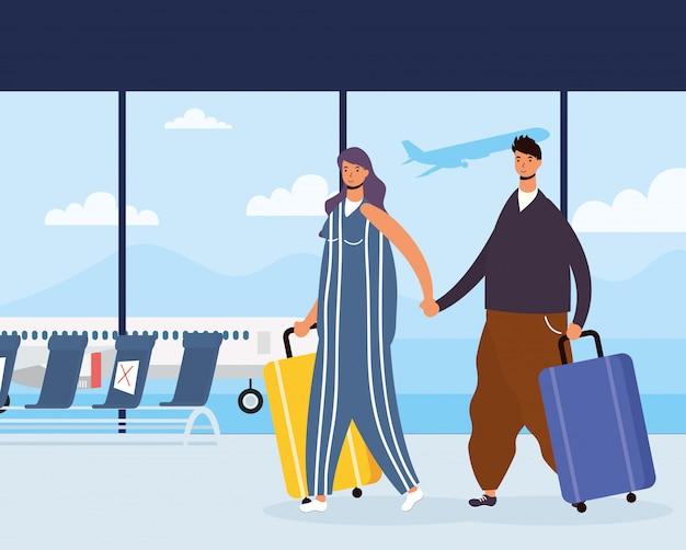 Молодая пара путешественников с чемоданами
