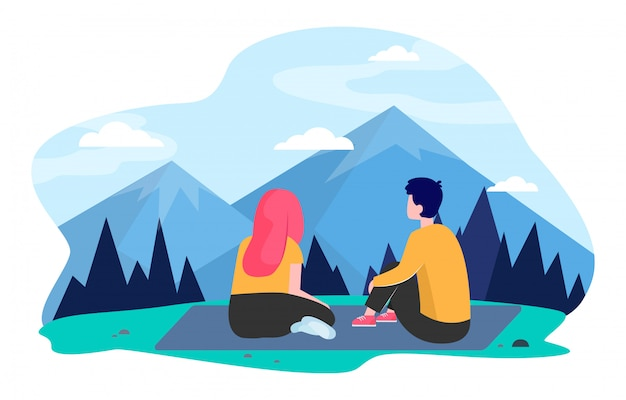 山を旅する若いカップル