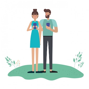 Young couple using smartphone in grass