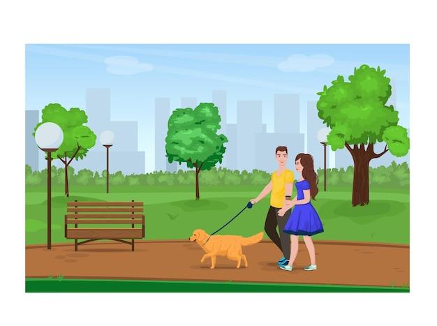 Молодая пара гуляет в парке с собакой