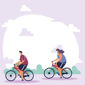 Молодая пара в медицинских масках на велосипедах