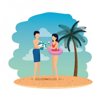 Young couple with balloon and float on the beach