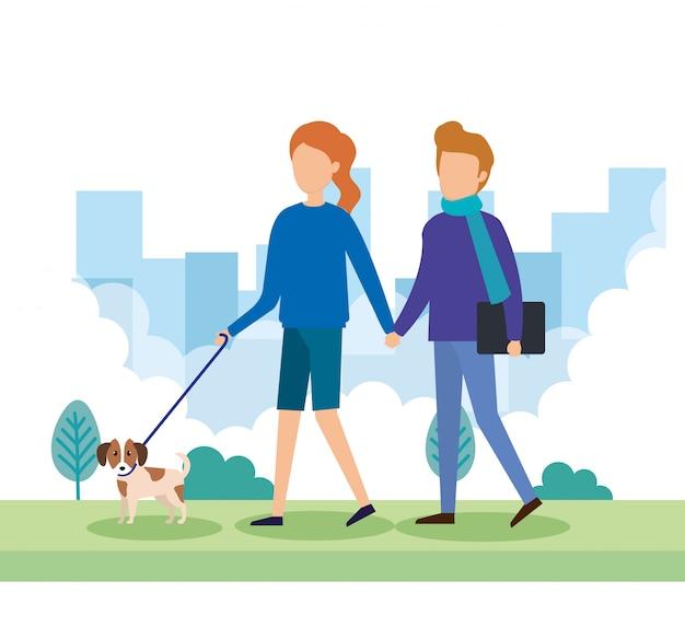 公園で犬と若いカップル