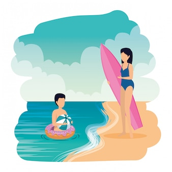 Young couple with float and surfboard on the beach