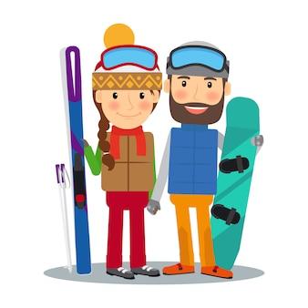 Молодая пара с лыжами и сноубордом