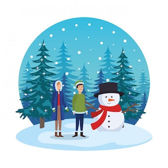Young couple with snowman in snowscape