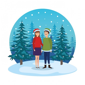 Young couple with winter clothes in snowscape
