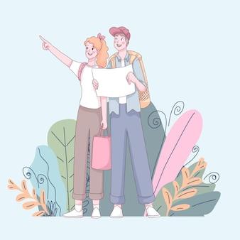 Giovane coppia carina con mappa e zaini.