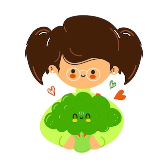 Young cute funny little girl hold broccoli in hand