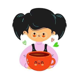 若いかわいい面白い小さな女の子は一杯のコーヒーを保持します