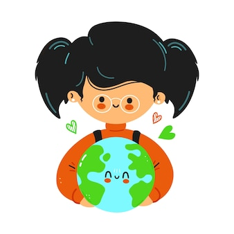 若いかわいい面白い少女は、惑星地球を手に持っています