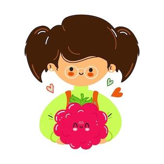 若いかわいい面白い小さな女の子は手にラズベリーを保持します