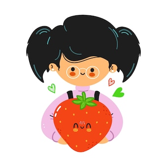 若いかわいい面白い少女は、イチゴを手に持っています