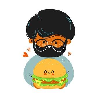 若いかわいい面白い男は、ハンバーガーを手に持っています