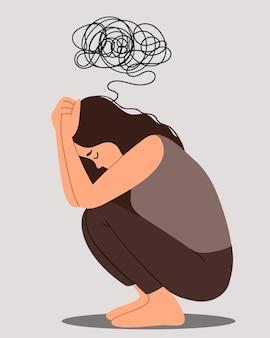 젊은 우울 여성 바닥에 앉아 무릎을 잡고