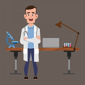 Young doctor stands near his table or workplace