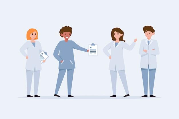 Giovani medici in piedi e che parlano l'un l'altro