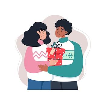 フラットスタイルで贈り物を保持している若い家族
