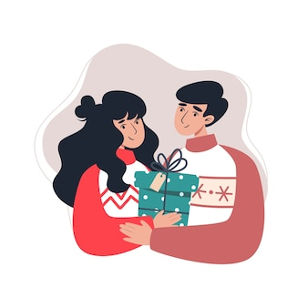 贈り物を持っている若い家族