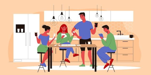 ゲームをしている台所のテーブルに座っている若い家族