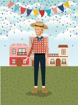 花輪と街並みを祝う若い農家