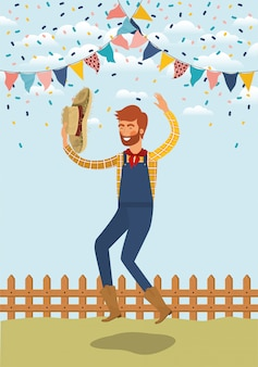 Young farmer celebrating with garlands and fence