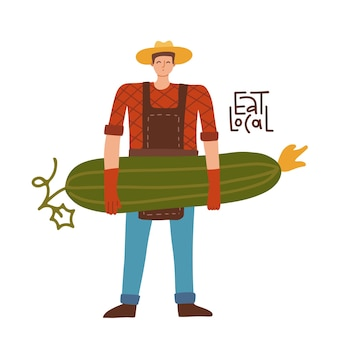천연 유기농 야채와 함께 큰 오이 남성 정원사 캐릭터를 들고 있는 젊은 농부 남자는 ...