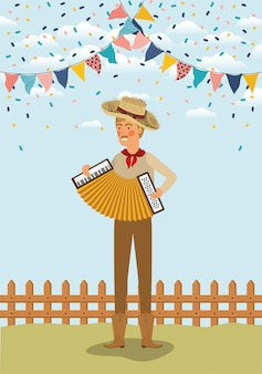 Young farmer playing accordion with garlands and fence