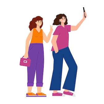 Молодые модные женщины делают селфи фото улыбающиеся счастливые девушки со смартфоном