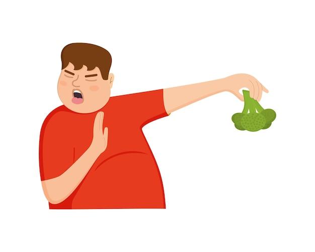 젊은 뚱뚱한 남자는 혐오의 제스처 표정을 거부하는 브로콜리 남자 먹기를 거부