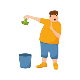 Young fat man refuse eating broccoli and throws it in trash can guy with refusing gesture facial exp