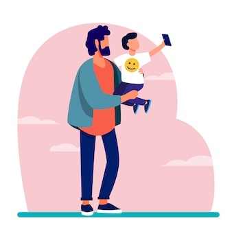 Young father holding child with mobile phone