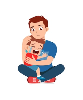 Young father hug crying little boy and try to comfort