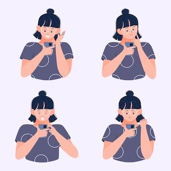 若い女性が異なる表現でスマートフォンでメッセージを読む